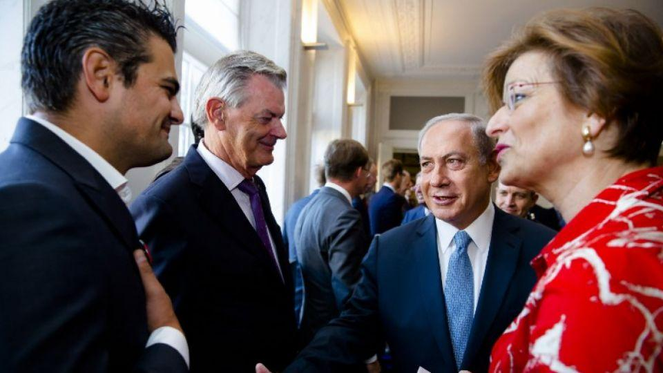 Dutch Parliament Member Tunahan Kuzu (L) refuses to shake hands with Prime Minister Benjamin Netanyahu during his visit to the States General at the Binnenhof as part of Netanyahu's visit to the Netherlands at the Binnenhof, in the Hague, on September 7,