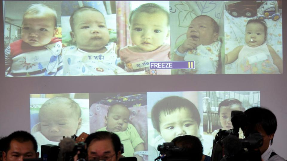 Surrogate babies that Thai police suspect were fathered by a Japanese businessman who has fled from Thailand are shown on a screen during a news conference at the headquarters of the Royal Thai Police in Bangkok August 12, 2014.