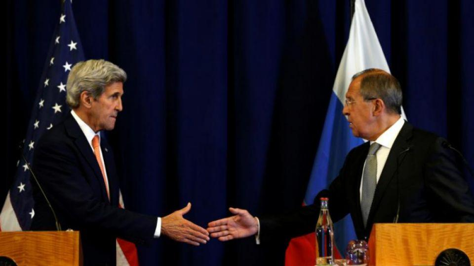 US Secretary of State John Kerry and Russian Foreign Minister Sergei Lavrov (R) shake hands at the conclusion of their news conference following their meeting in Geneva, Switzerland.