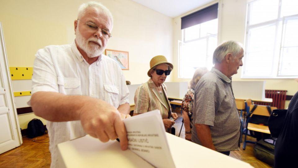 A voter casts his ballot at a polling station during the general election in Zagreb, Croatia, on September 11, 2016.