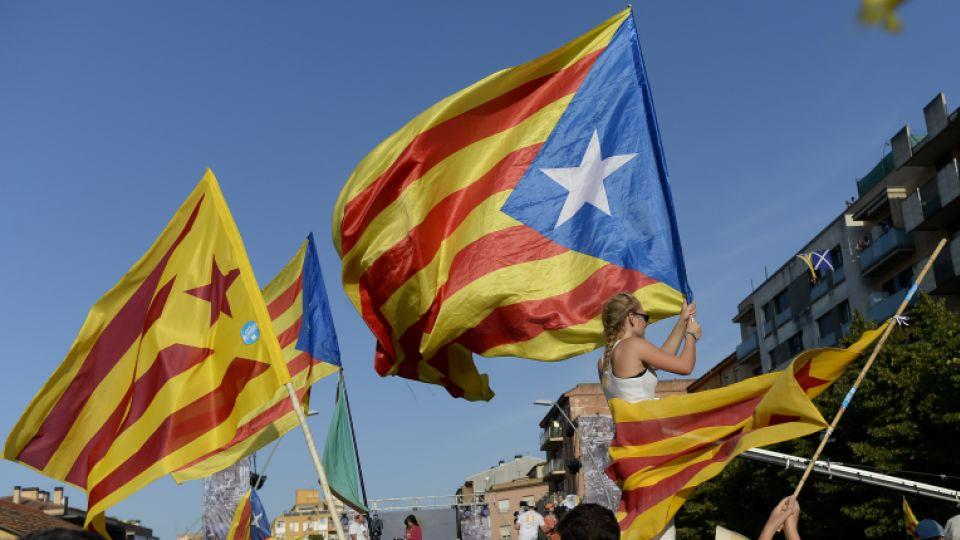 """People wave """"Estaladas"""" (pro-independence Catalan flags) as they gather during a pro-independence demonstration, on September 11, 2016, in Barcelona during the National Day of Catalonia, """"La Diada."""""""