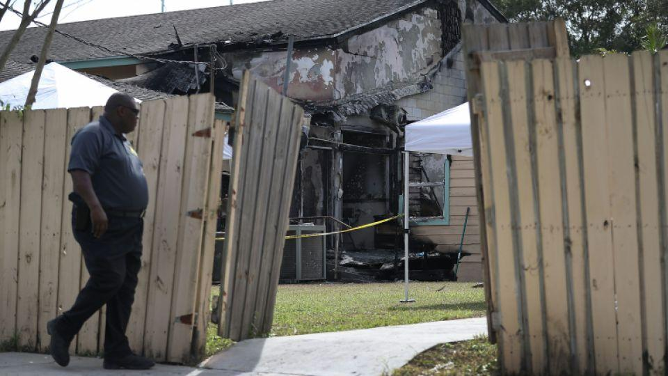 A Law enforcement official walks near the scene of a fire at the Islamic Center of Fort Pierce.