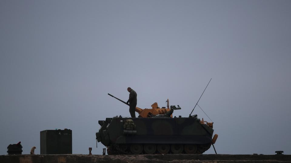 A Turkish soldier stands on an armoured vehicle in a village near the Turkish-Syrian border in Hatay province, Turkey, February 25, 2018.