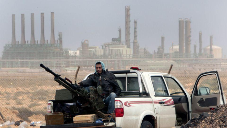 A loyalists to General Khalifa Haftar sits with an anti-aircraft weapon in front Ras Lanouf oil refinery in eastern Libya. The US and five European nations have called upon forces loyal to the general to withdraw from three oil terminals seized this week.