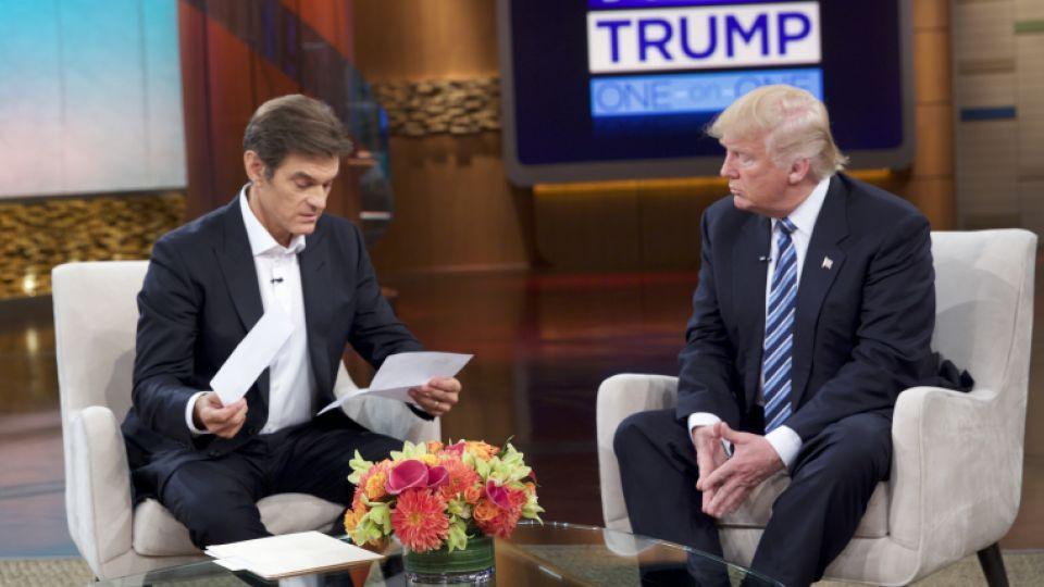 Dr. Oz looks over a summary of the Donald Trump's health report.