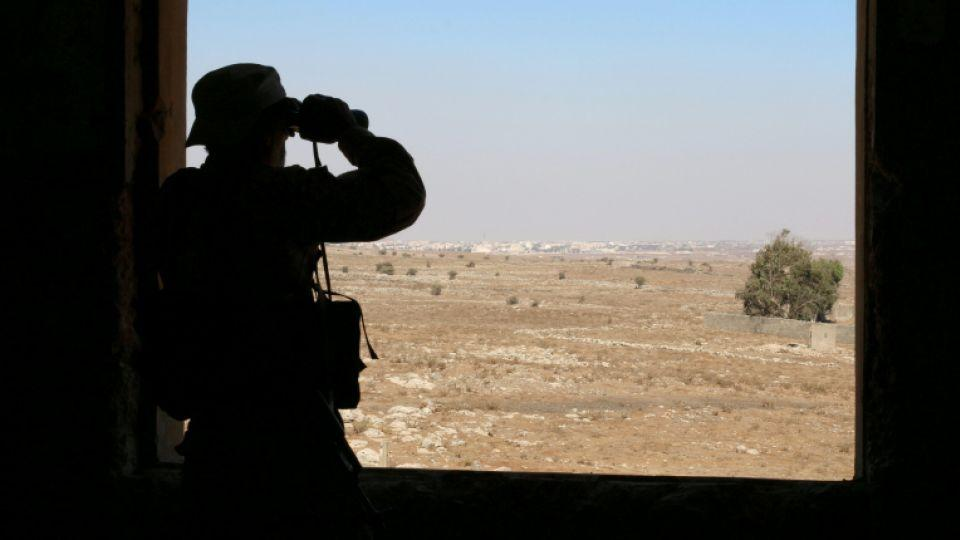 A rebel fighter looks through binoculars in Quneitra countryside, Syria September 10, 2016