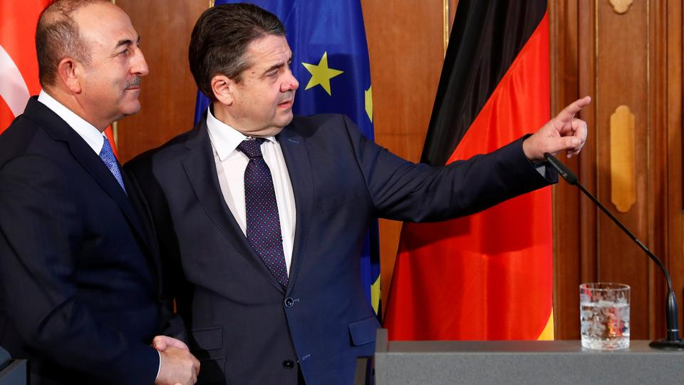 Turkish Foreign Minister Mevlut Cavusoglu and his German counterpart Sigmar Gabriel talk after a statement in Berlin, Germany, March 6, 2018.