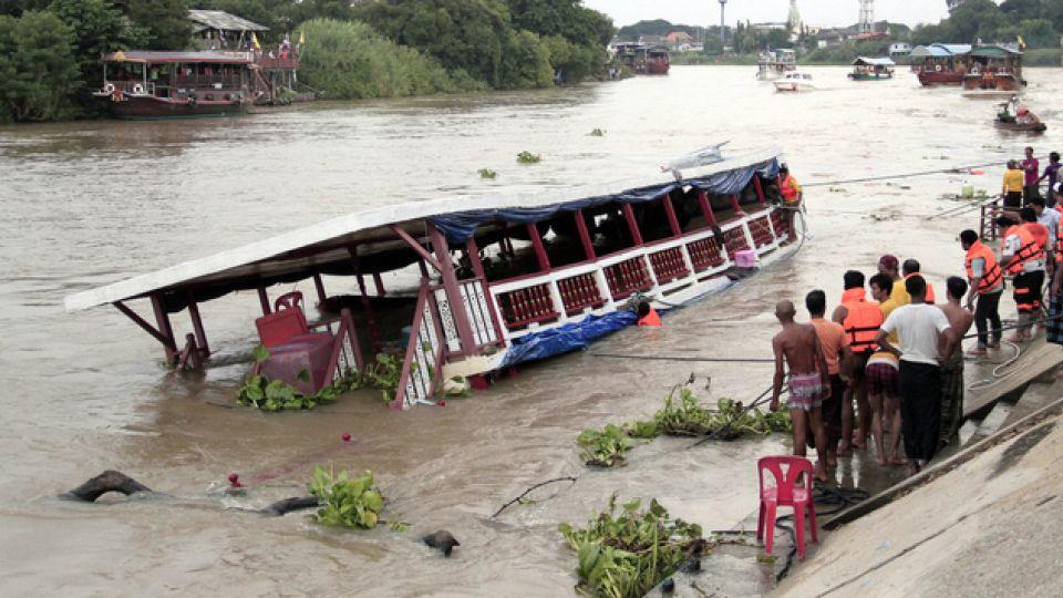 Thai rescue officials searching for victims at the site of accident.