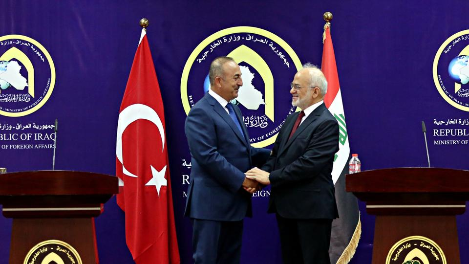 In this August 23, 2017 file photo, Turkish Foreign Minister Mevlut Cavusoglu, left, shakes hands with Iraqi Foreign Minister Ibrahim al Jaafari after a joint press conference in Baghdad, Iraq.
