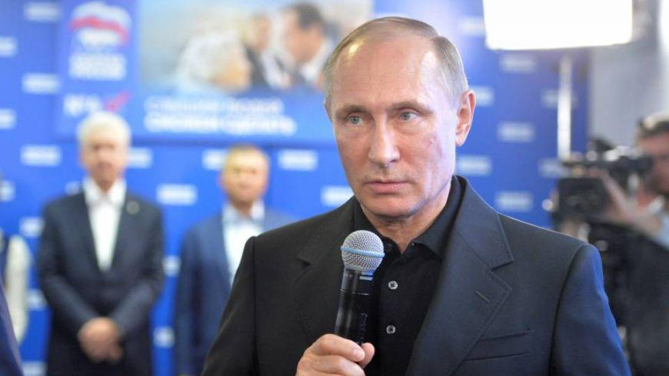 Russian President Vladimir Putin speaks at the United Russia party's campaign headquarters following a parliamentary election in Moscow on Sunday.