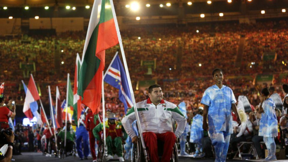 A Bulgarian athlete brings in his countries a flag during the closing ceremony of the Rio 2016 Paralympic Games at the Maracana Stadium in Rio de Janeiro, Brazil, Sunday, Sept. 18, 2016.