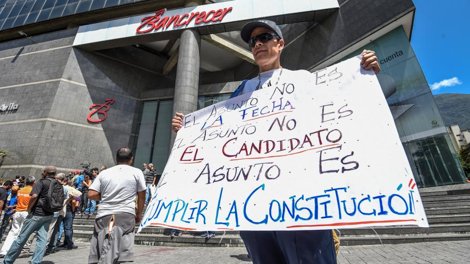 A member of the Venezuelan opposition demonstrates in front of the UN headquarters in Caracas against the alleged electoral fraud and the government of Nicolas Maduro, on March, 12, 2018.