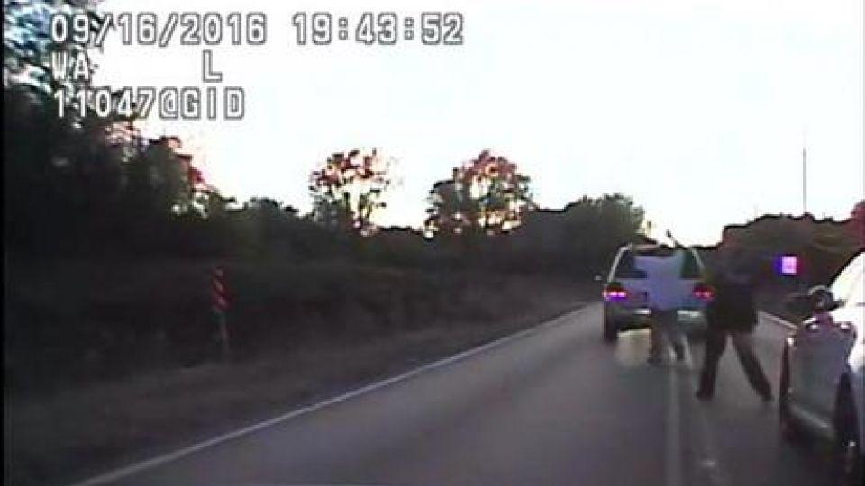 In this image made from a Friday, Sept. 16, 2016 police video, Terence Crutcher, left, is pursued by police officers as he walks to an SUV in Tulsa, Okla.