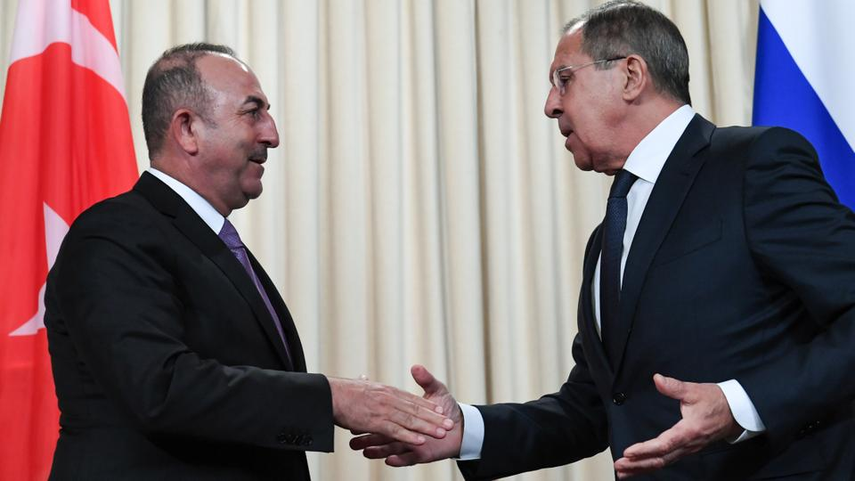 Us turkey talks may be postponed due to tillersons exit russian foreign minister sergey lavrov r shakes hands with his turkish counterpart mevlut cavusoglu m4hsunfo