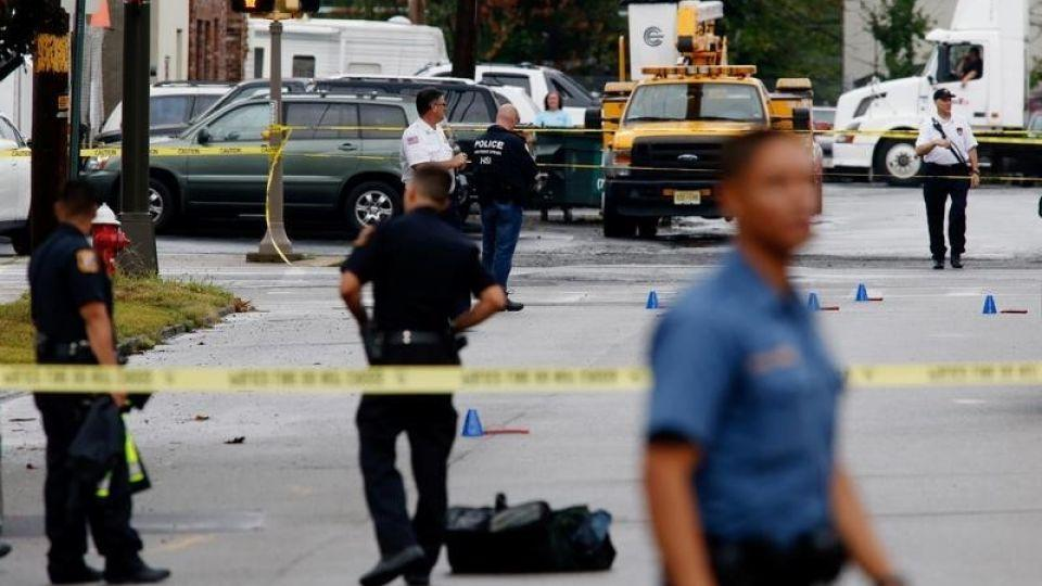 Law enforcement officers mark evidence near the site where Ahmad Khan Rahami, sought in connection with a bombing in New York, was taken into custody in Linden, New Jersey, U.S., September 19, 2016.