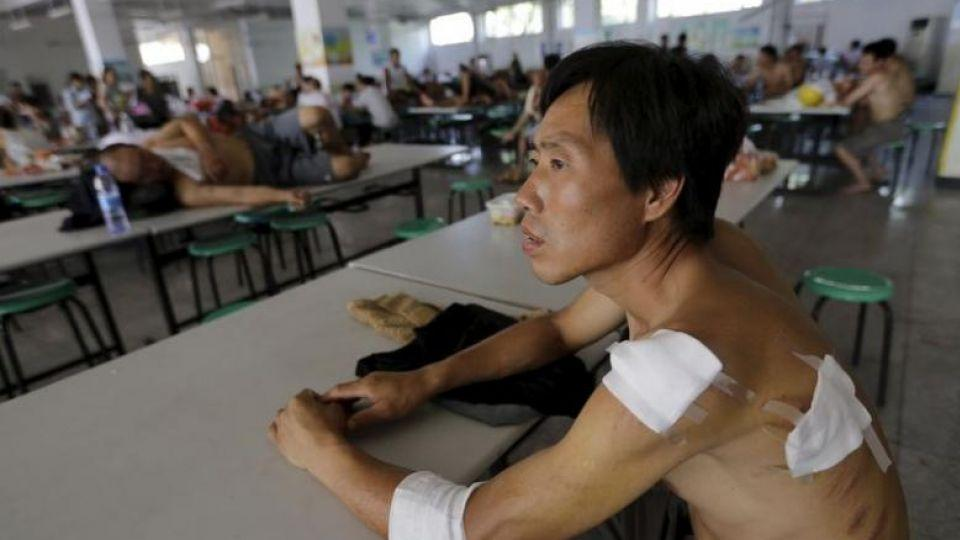 A man rests at dining hall of a primary school, which has been turned into a shelter affected by the 2015 chemical explosions in Tianjin.