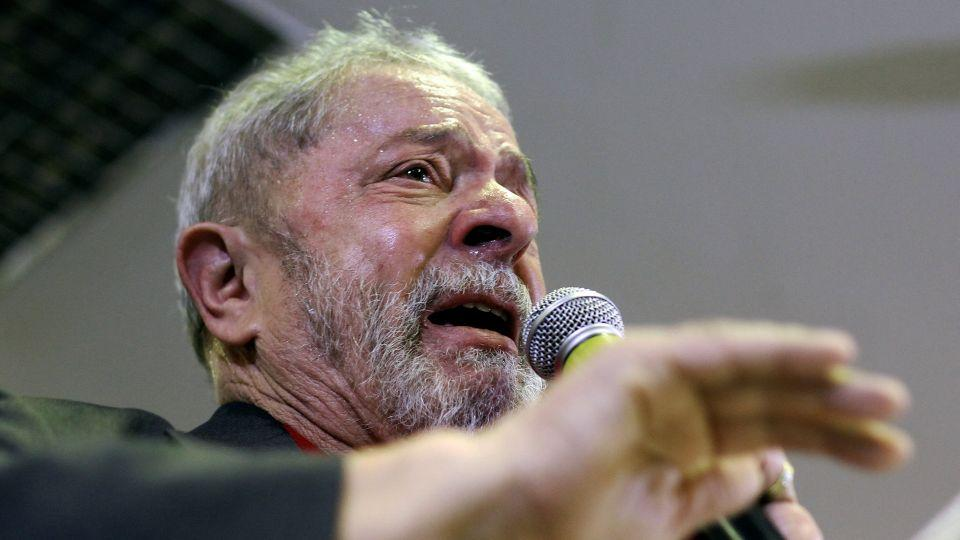 Lula says corruption accusations are politically motivated and isn't getting him down.