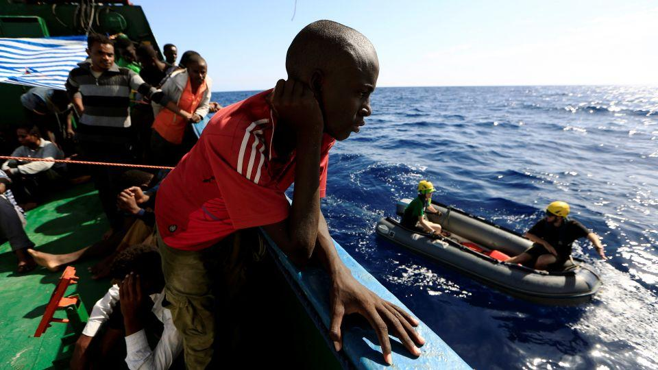 A refugee is seen after he was rescued from an overcrowded dinghy by members of the German NGO Jugend Rettet during an operation in the Mediterranean Sea, September 21, 2016.