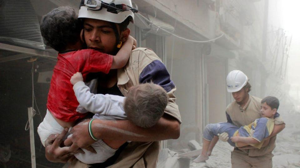 Members of Syria Civil Defense rescue children after what activists said was an air strike by forces loyal to the Syrian regime in the al-Shaar neighbourhood of Aleppo, Syria, June 2, 2014.