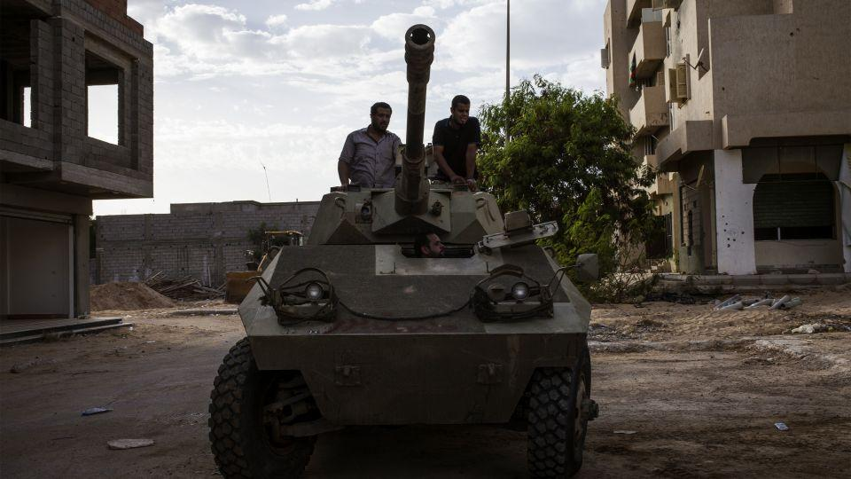 Misrata's fighters are pictured on a tank during clashes against DAESH in Sirte, Libya, on September 21, 2016.