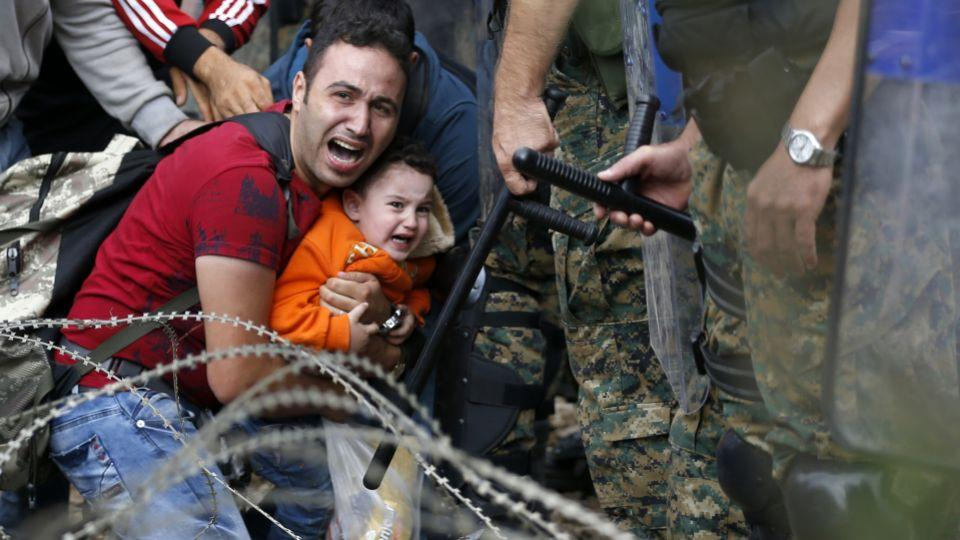 Picture shows refugees waiting to be allowed by the Macedonian police to cross the border from Greece to Macedonia, Aug. 21, 2016.