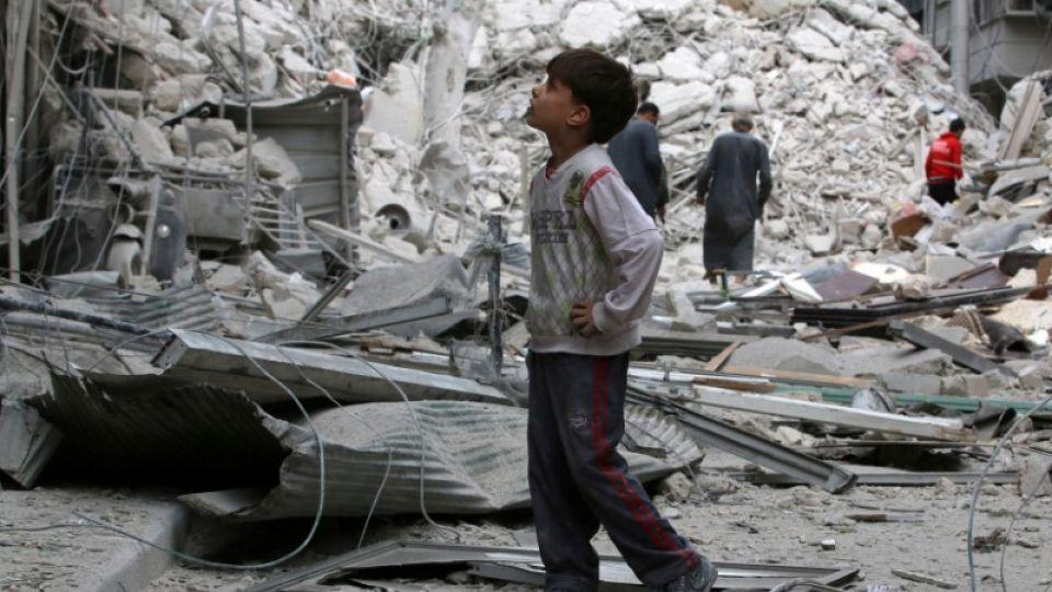 A boy inspects a damaged site after airstrikes on the rebel held Tariq al-Bab neighbourhood of Aleppo, Syria September 23, 2016.