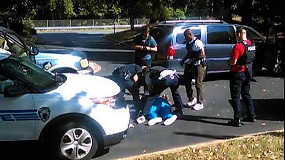 This video frame grab obtained September 23, 2016, taken by Rakeyia Scott, courtesy of Curry Law Firm, shows the moments after the shooting of Keith Lamont Scott in Charlotte, North Carolina.