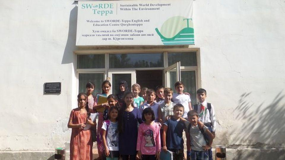 Students in front of the Sworde Teppa school, which offers Tajik children an opportunity to study English for free.