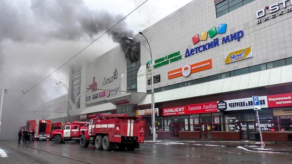 This handout picture released by The Russian Emergency Situations Ministry on March 25, 2018, shows emergency vehicles as they gather outside a burning shopping centre in Kemerovo.