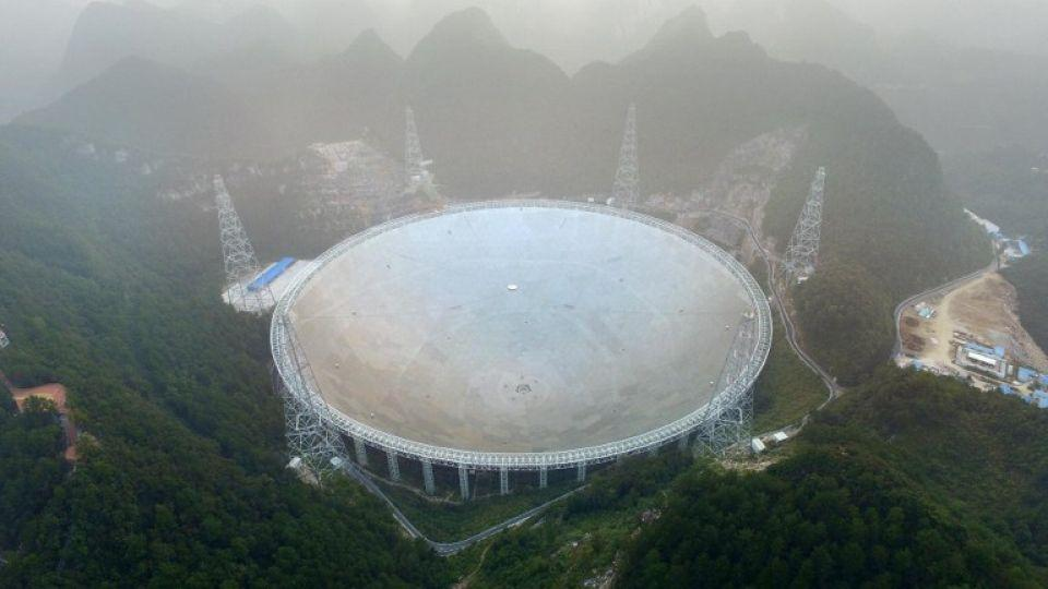 The Five-hundred-metre Aperture Spherical Radio Telescope (FAST) is seen on its first day of operation in Pingtang, in southwestern China's Guizhou Province on September 25, 2016.