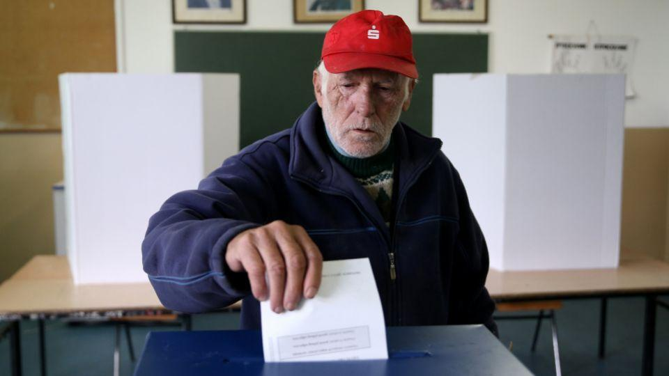"A man votes during a referendum on Bosnia's Republika Srpska should celebrate ""Statehood Day"" in Laktasi near Banja Luka, Bosnia and Herzegovina, September 25, 2016."