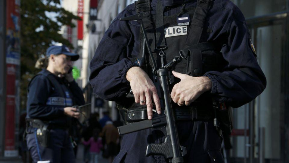 Armed French police stand guard outside a commercial centre in Nice.