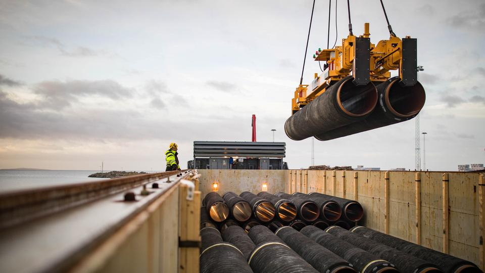Pipes are loaded onto a vessel in the northern port of Mukran, on the island of Ruegen, Germany, on February 28, 2018.