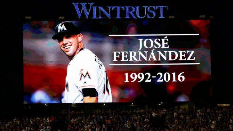 Fans at Wrigley Field stand for a moment of silence Sunday night in honor of Miami Marlins pitcher Jose Fernandez, who was killed in a boating accident at age 24.