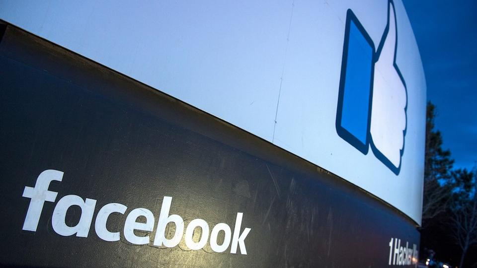 In this file photo taken on March 21, 2018 a lit sign is seen at the entrance to Facebook's corporate headquarters location in Menlo Park, California.