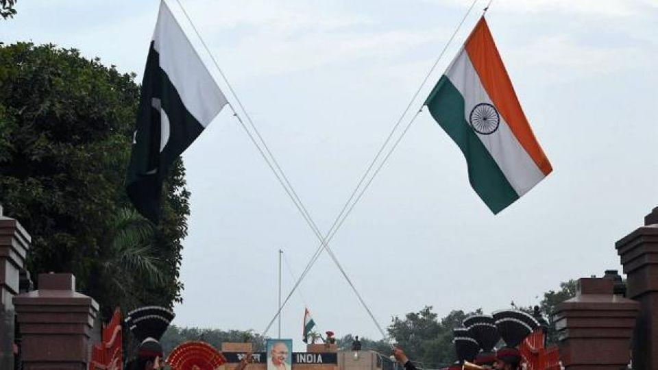 Flags of Pakistan (L) and India (R) appear hoisted at Wahga border.
