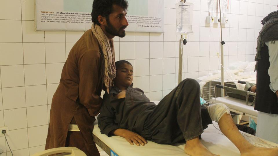An Afghan resident is treated at a hospital following an air strike in Kunduz on April 2, 2018.