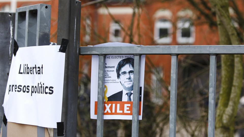 A picture of Carles Puigdemont is fixed in front of the entrance of a prison in Neumuenster, northern Germany, Tuesday, March 27, 2018, where Puigdemont, the fugitive ex-leader of Catalonia and ardent separatist, is believed to be held after he was arrested.