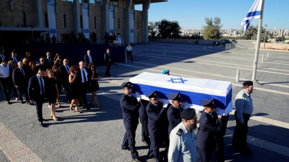 People from all around the world paid their tributes to Peres, who died at age 93. Family members of former Israeli President Shimon Peres are seen here walking past his coffin during a ceremony at the Knesset, the Israeli parliament, Sep.30, 2016.