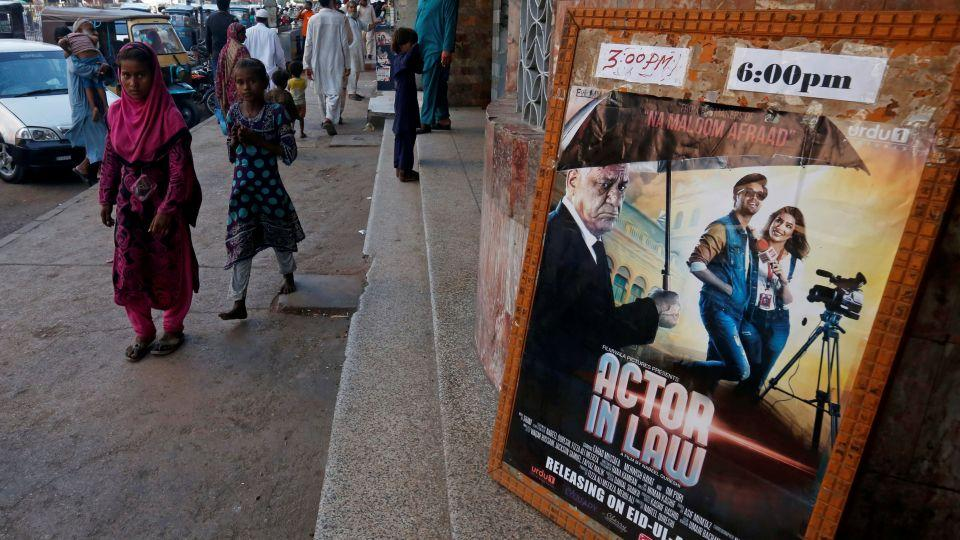 An poster for a Pakistani film with Indian actors is seen outside a movie theater in Karachi