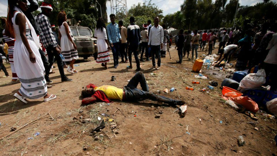 An injured protester waits for help after several people died during the Irrechaa, the thanks giving festival of the Oromo people in Bishoftu town of Oromia region, Ethiopia, October 2, 2016.