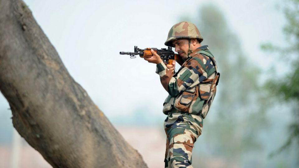 An Indian soldier takes up position at an outpost at the India-Pakistan border in R.S Pora south-west of Jammu on October 2, 2016.