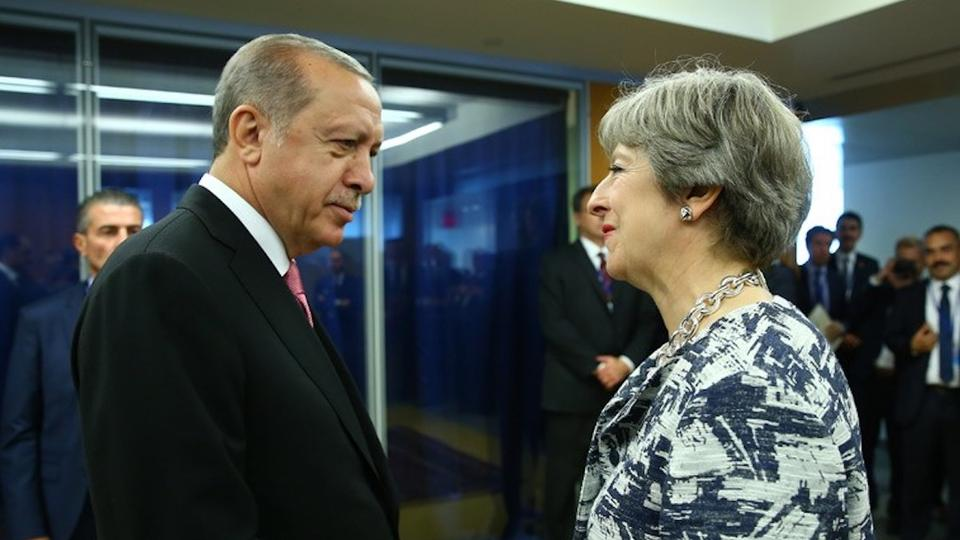 File Photo: Turkish President Recep Tayyip Erdogan (L) told the UK's PM Theresa May (R) that Ankara considers the air strikes against the Assad regime were