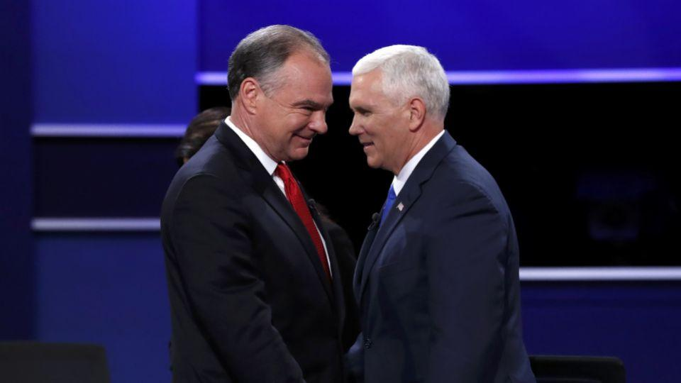 Democratic US vice presidential nominee Senator Tim Kaine (L) and Republican US vice presidential nominee Governor Mike Pence pass each other on stage at the conclusion of their vice presidential debate at Longwood University in Farmville, Virginia, USA.