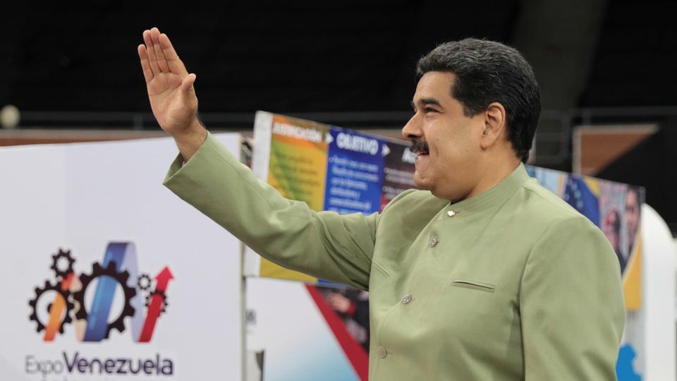 Venezuela's President Nicolas Maduro waves as he attends Venezuela Potential Expo in Caracas, Venezuela on April 26, 2018.