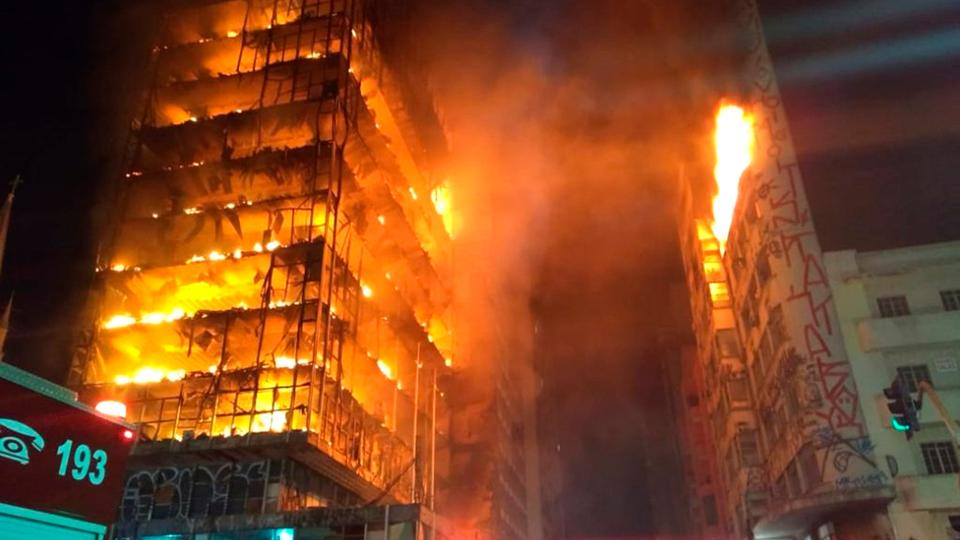 In this photo released by Sao Paulo Fire Department, a building on fire is seen in Sao Paulo, Brazil, Tuesday, May 1, 2018. A burning building in downtown Sao Paulo has collapsed as firefighters worked to put out a fire that began in the middle of the night.