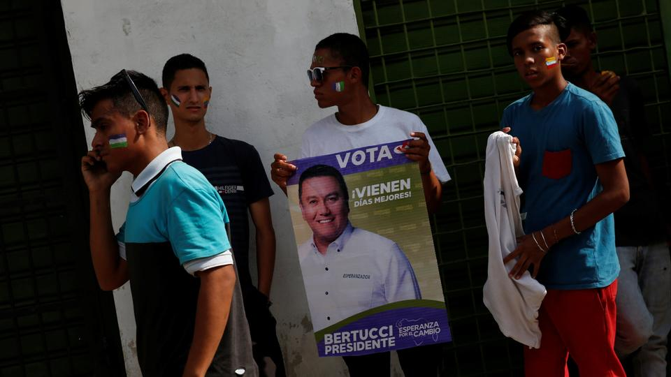 leading politicians are in jail, exiled or barred from standing. The coalition says the vote is a sham designed to legitimize President Nicolas Maduro. That decision has left space for alternatives such as Bertucci and Maduro's main challenger, former state Governor Henri Falcon. Many opposition supporters distrust the two candidates and plan to abstain from voting, but having two rival opposition candidates will split the votes of those who do go to the polls.