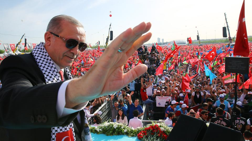 Turkish President Recep Tayyip Erdogan greets people during rally in solidarity with Palestinians.
