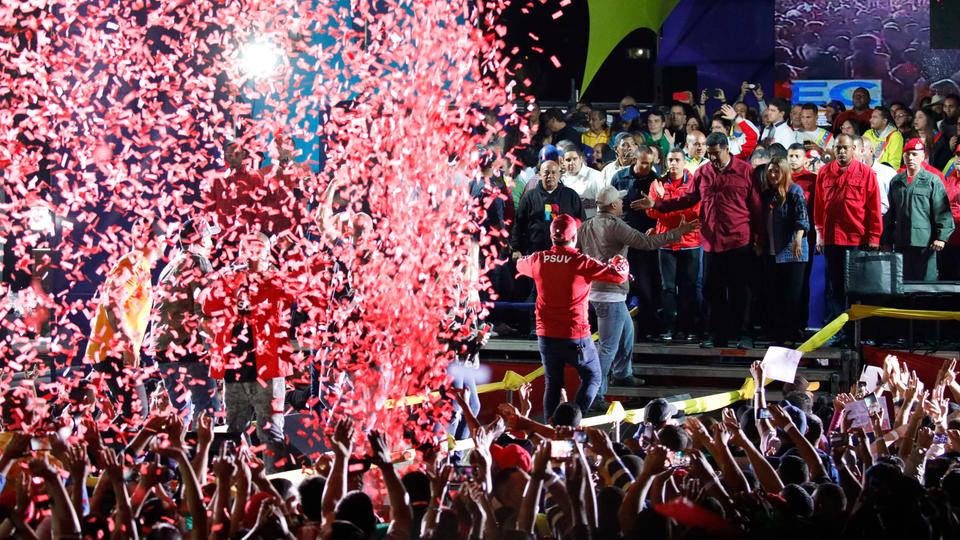 Confetti falls as supporters walk up to greet Venezuela's President Nicolas Maduro (center, R, in red) during a gathering after the results of the election were released, outside of the Miraflores Palace in Caracas, Venezuela, May 20, 2018.