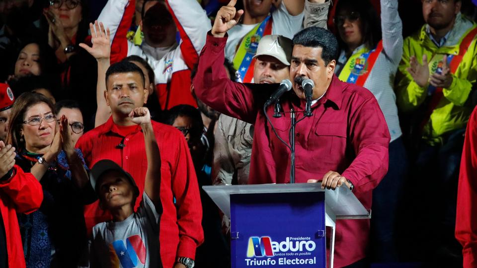 Venezuela's President Nicolas Maduro is surrounded by supporters as he speaks during a gathering after the results of the election were released, outside of the Miraflores Palace in Caracas, Venezuela, May 20, 2018.